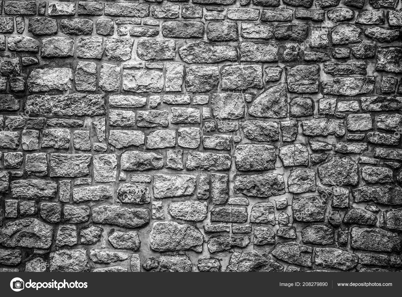Old stone wall background black white photo stock photo