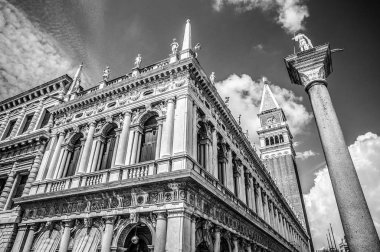 VENICE, ITALY - AUGUST 19, 2016: Piazza San Marco with the Basilica of Saint Mark and the bell tower of St Mark's Campanile (Campanile di San Marco) close-up on August 19, 2016 in Venice, Italy.