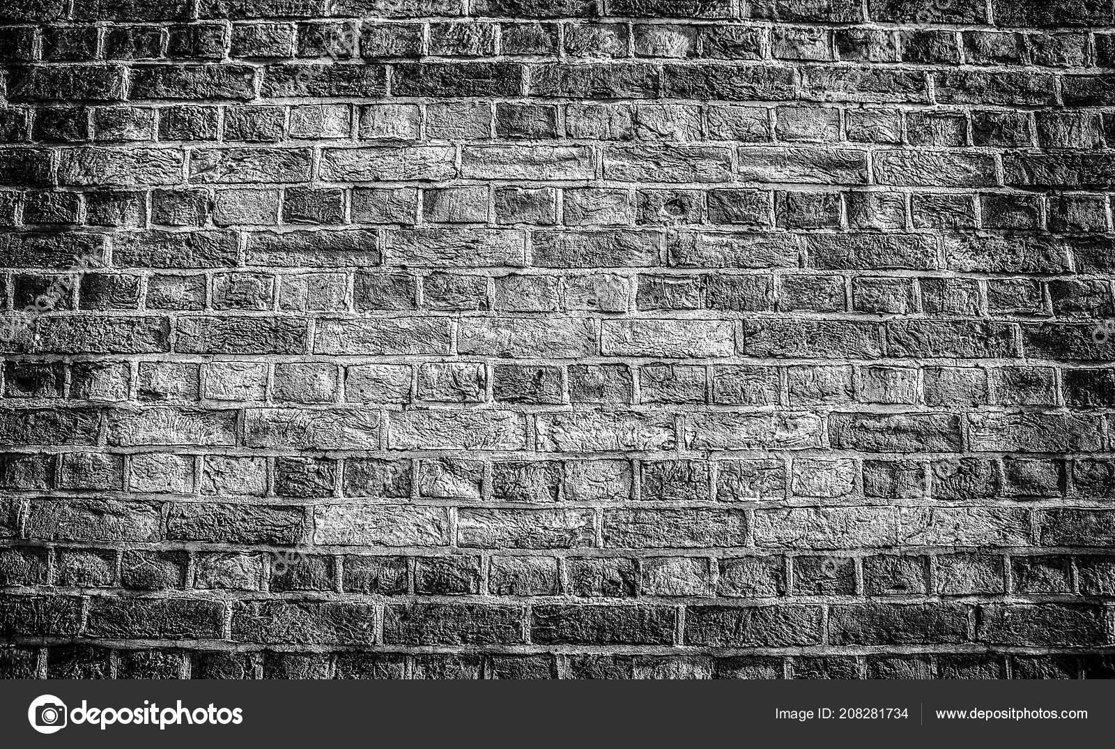 Old stone wall background black white photo stock photo
