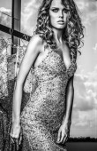 Elegant young beauty woman in luxury dress. Black-white photo.