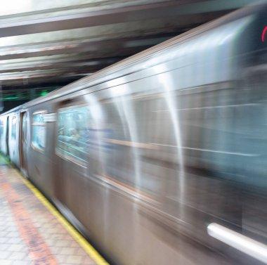 Blurred scene in New York subway station.