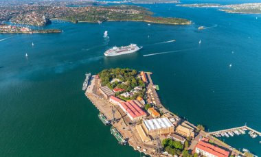 Aerial overhead view of Garden Island in Sydney with leaving cruise ship, Australia.
