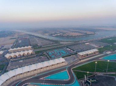 Yas Island, Abu Dhabi. Aerial view of city car circuit at dusk, United Arab Emirates.