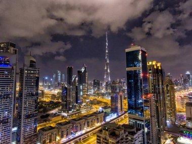 Night aerial view of Dubai Downtown skyscrapers, United Arab Emirates.