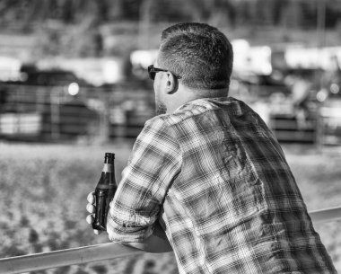 BRYCE CANYON CITY - JUNE 21, 2018: Man watches the show sipping a beer at Ruby's Inn Bryce Canyon Country Rodeo.