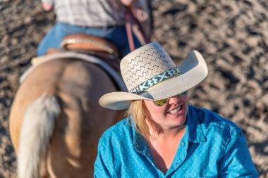 BRYCE CANYON CITY - JUNE 21, 2018: Cowgirl after riding her horse at a rodeo show at Ruby's Inn Bryce Canyon Country Rodeo.