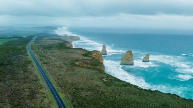 The Great Ocean Road on a stormy day. Twelve Apostles and coastline.