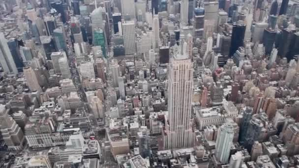 NEW YORK CITY - DECEMBER 2018: Aerial view of Empire State Building and Midtown Manhattan aerial skyline from helicopter