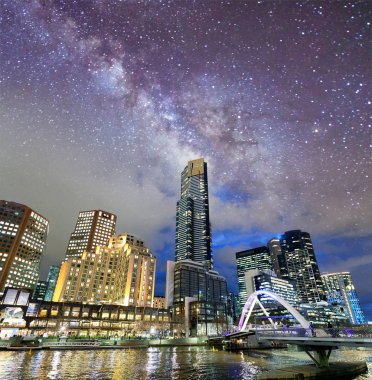 Night city view of buildings along Yarra River, Melbourne. Starry night.