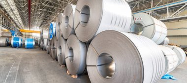 Industrial warehouse with rolls of steel sheet in a plant galvan
