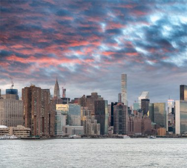 Sunset reflections of Midtown Manhattan, view from the river at