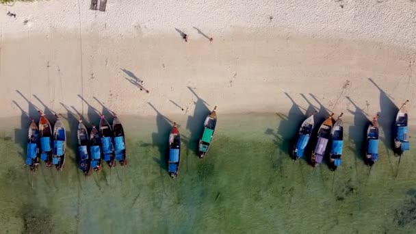 Amazing overhead aerial view of Long Tail Boats on a Thailand Beach Shoreline