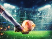 Soccer player with soccerball on fire at the stadium during the match