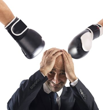 Businessman receives fists from competitors. concept of difficult career