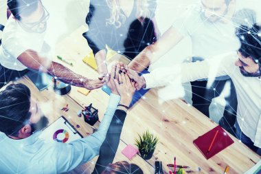 Business people putting their hands together. Concept of integration, teamwork and partnership. double exposure