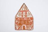 das Lebkuchenhaus mit Oktoberfest-Inschrift auf weißem Hintergrund