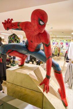 MILAN, ITALY - CIRCA NOVEMBER, 2017: life-sized figure of Spider-Man at Rinascente shopping center in Milan.