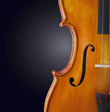 violin background. classical wooden musical instrument on dark backdrop