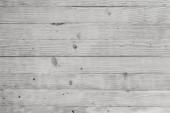 Fotografia sfondo chiaro di nuove tavole in legno