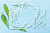 Fotografie lilies of the valley on  wooden background