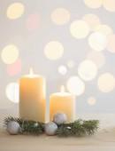 Photo burning candle  on white background