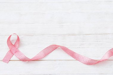 pink ribbon as  symbol of fighting breast cancer