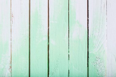 white and green painted wooden background