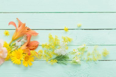 Yellow and orange flowers on green wooden background stock vector