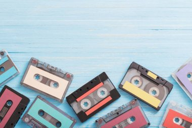 Old plastic cassette on wooden background. Retro music concept