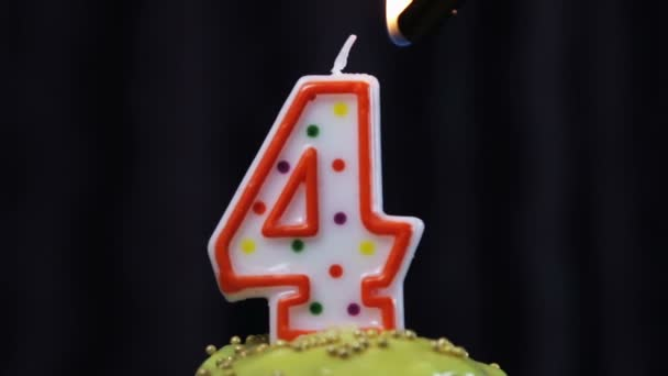 Cupcake With A Burning Candle The Number 4 Stock Footage