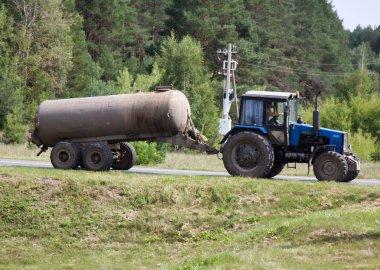 wheel tractor carries tank