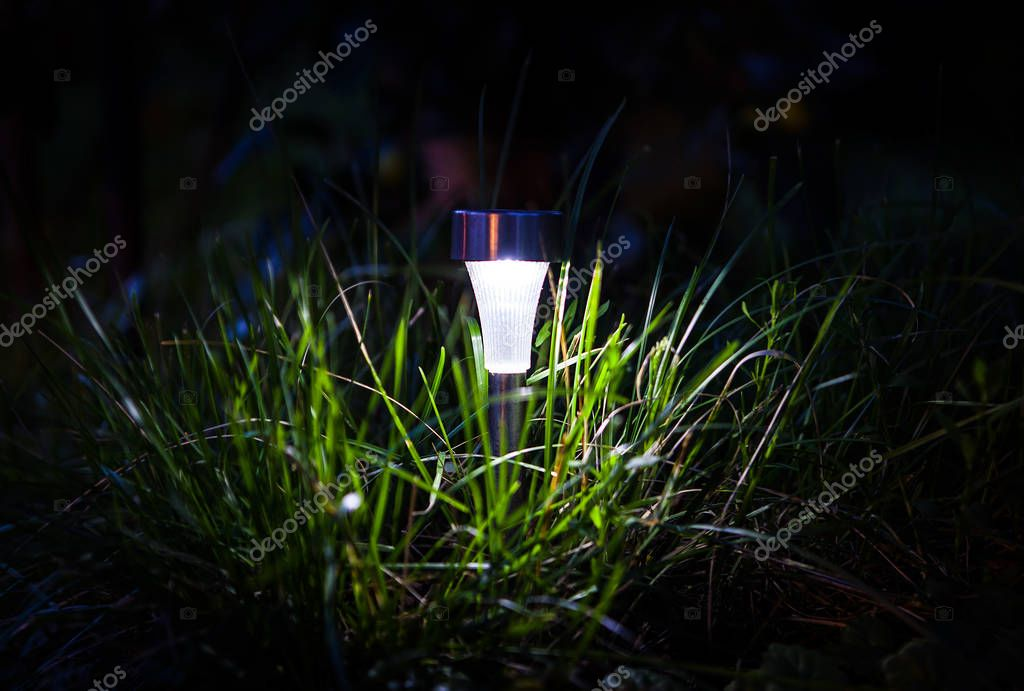 Solar Powered Lamp in the Grass in the Night