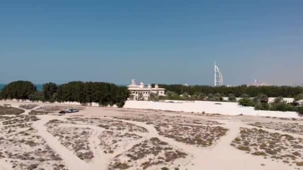 Flying up from the desert opens up the view of the hotel Burj Al Arab Jumeirah .
