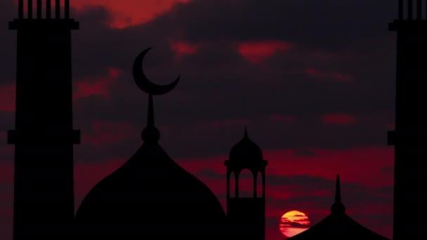 Silhouette einer Moschee vor dem Hintergrund des Sonnenaufgangs.