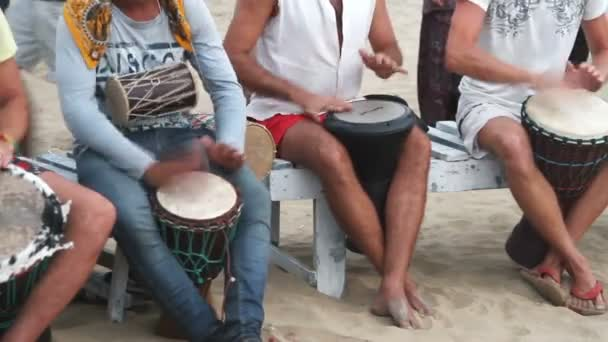 Goa, India  February 28, 2015: Unidentified man playing on drum at the beach.