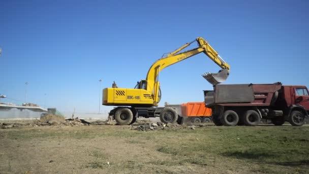 Volgograd, Russian Federation  September 25, 2017: Excavator loading soil from construction site of stadium Volgograd Arena into a dumper truck