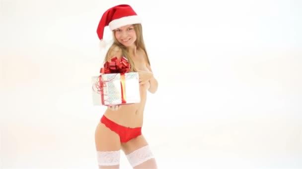 Santa kalap, ajándék doboz tánc a karácsonyi gyönyörű meztelen nő