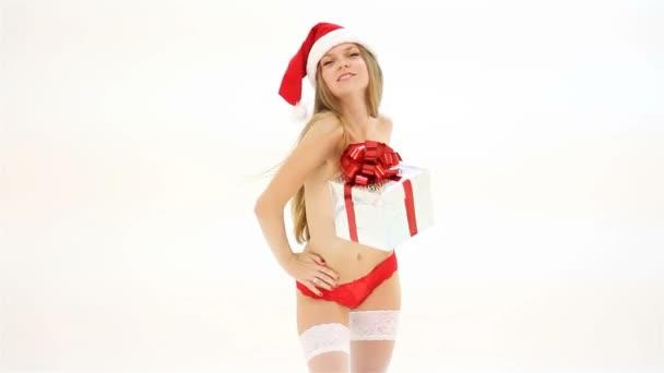 krásná nahá žena Vánoce v santa hat s dárkové krabice tanec