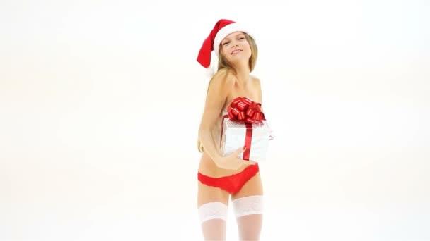 Beautiful nude christmas woman in santa hat with gift box dancing