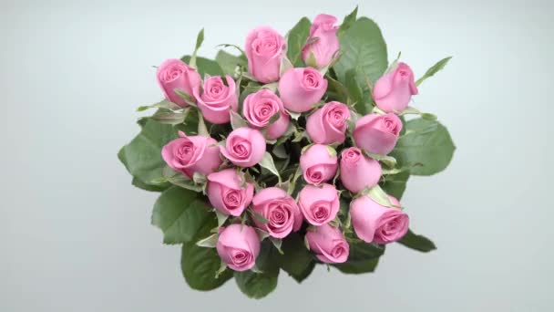 Womens hands put a bouquet of pink roses and present on the table. 19. Part 3.