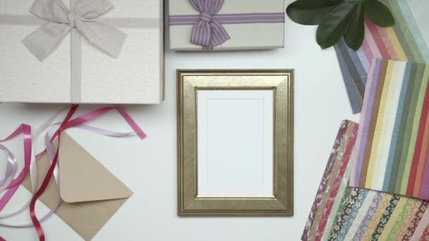 Wrapping photo frame as gift on the table. Static shot. 06.