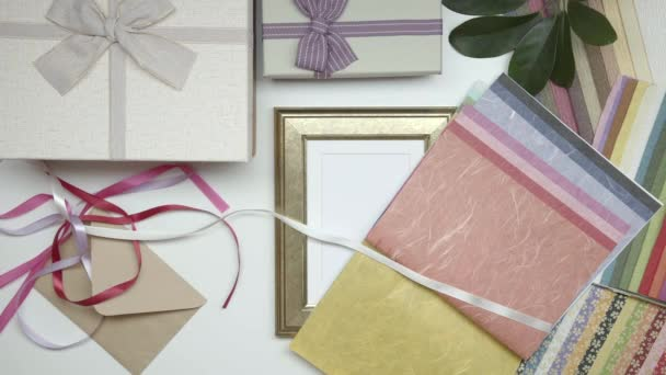 Wrapping photo frame as gift. Choose decor. Static shot. 10.