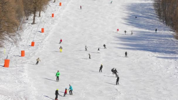 Skiing slopes with skiers