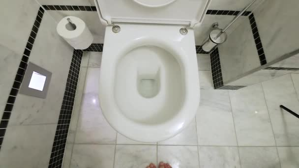 Toilet leaning out slow motion
