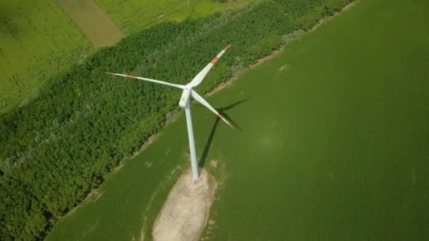 Wind tubine spinning, aerial drone footage