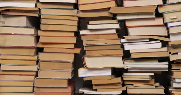 Wall of books in a pile