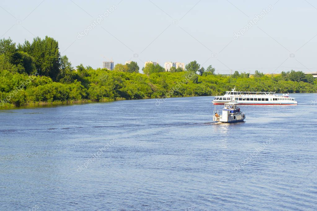Tyumen, Russia, on July 16, 2018: Admiral and Tyumen motor ships float with passengers down the river
