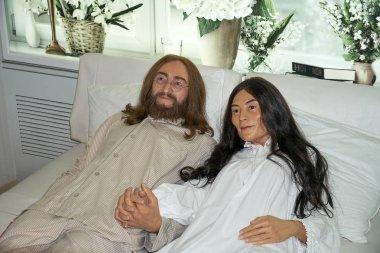 MONTREAL, CANADA - SEPTEMBER 23, 2018: John Lennon and Yoko Ono in the bed. Wax museum Grevin in Montreal, Quebec, Canada
