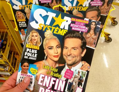 A hand holding Star Magazine