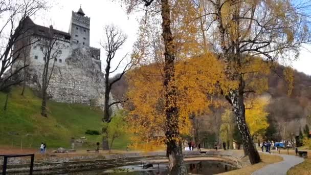 Bran, Romania - 29 October, 2018: People walking by the Bran Castle in Transylvania. The castle is known as Draculas Castle.
